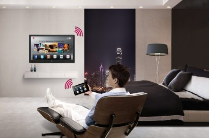 A gentleman using the LG Pro-Centric® Smart Hotel TV in his room