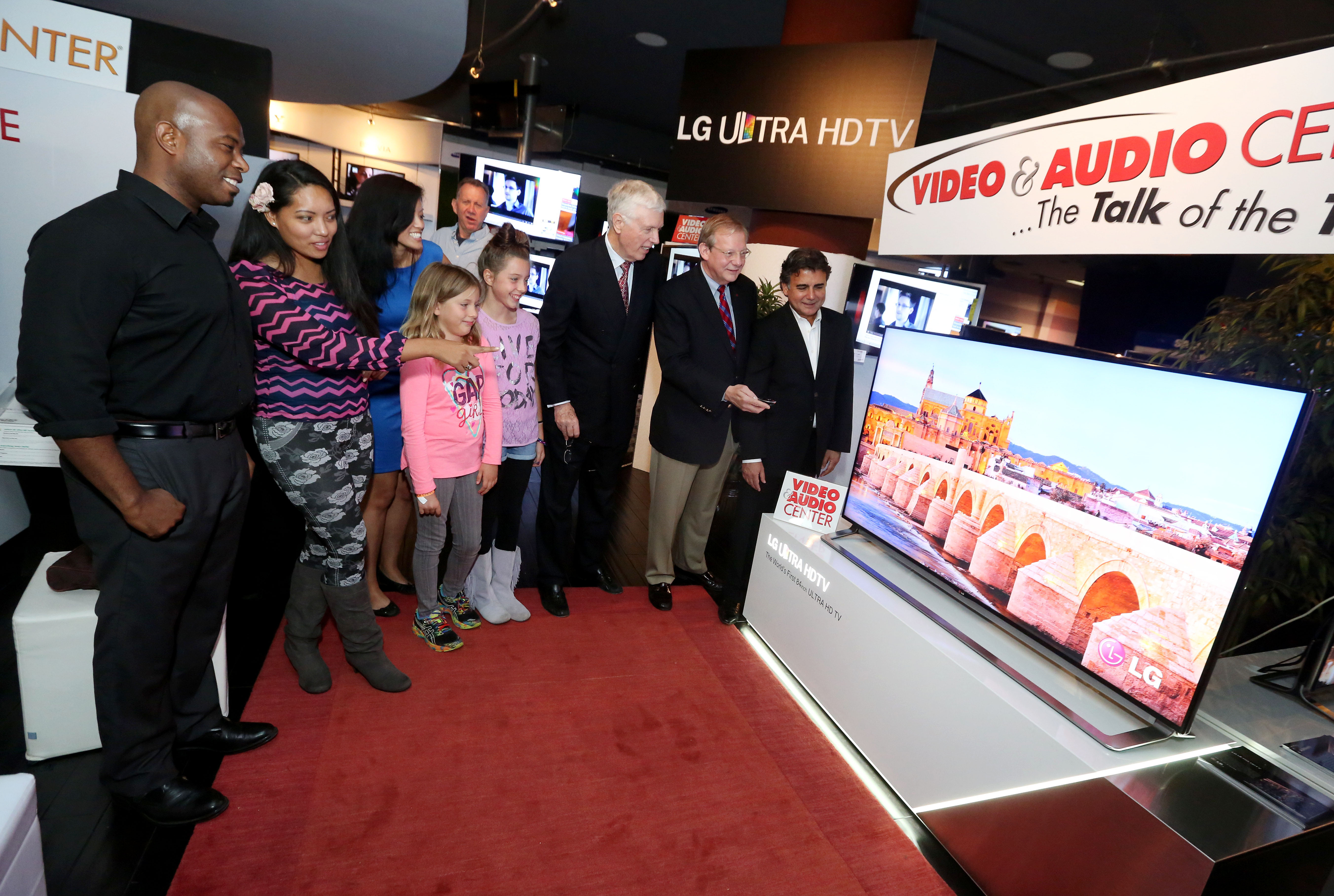 Visitors look at the LG Ultra HD TV model LA9700 on display at the Video&Audio Center