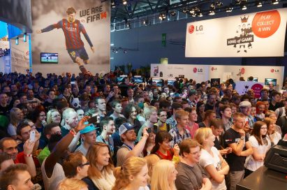 A large audience gathers at the main LG & EA stage at Gamescom 2013