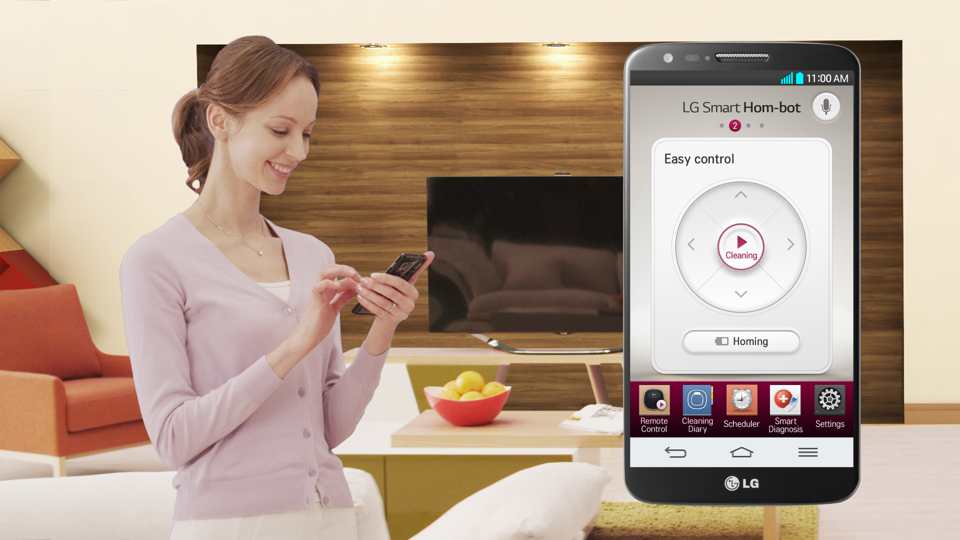 A woman remotely controlling her LG HOM-BOT with the smart app on her phone