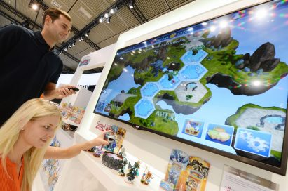 Visitors to the LG booth at IFA 2013 play popular family-friendly video game 'Skylanders Battlegrounds®' with the LG CINEMA 3D Smart TV