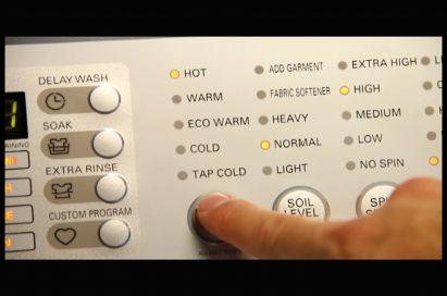 Close-up view of LG washing machine's control panel