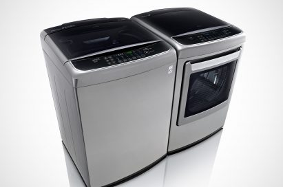 Side view of LG top-load washing machine and front-load dryer with digital control panel
