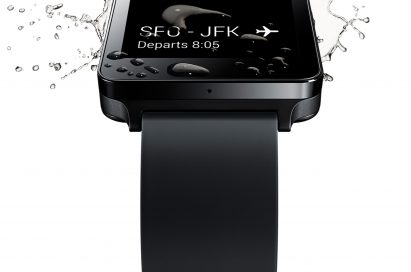 Water drops and spreads on the Titan Black LG G Watch's screen, which is showing the user's flight departure details.