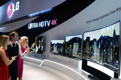 Models look at LG ULTRA HD TVs.