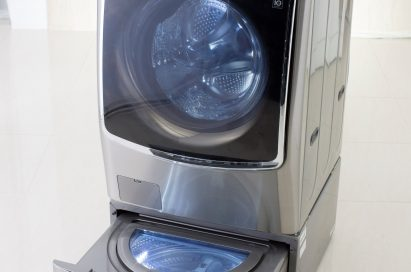 Right side view of LG TWINWash™ washing machine slightly facing left side with its Mini washer opened