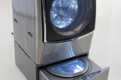 Left view of LG TWINWash™ washing machine with its Mini washer opened