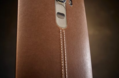 A back view of LG G4 wearing brown leather cover from low to high view.