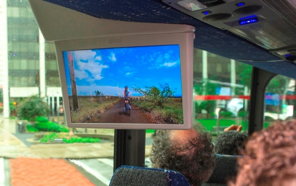 Experts watch videos on a bus via ATSC 3.0 signals.