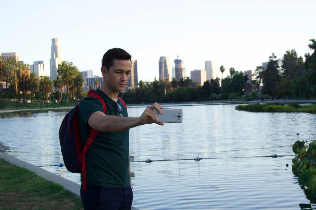 American actor, writer and director Joseph Gordon-Levitt takes a picture with the LG V10