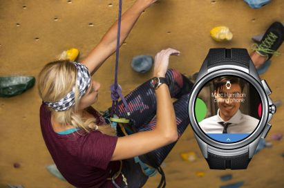 A woman looks at the LG Watch Urbane 2nd Edition on her wrist to receive an incoming call while rock climbing