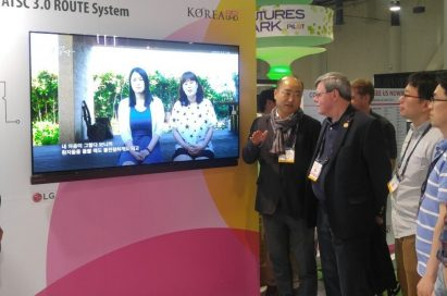 Visitors to LG's booth at the 2016 National Association of Broadcasters (NAB) convention observe and discuss the company's ATSC 3.0 smart antenna.