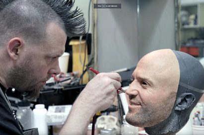 A man airbrushes a face mask of Jason Statham used during filming of LG G5 TV Commercial, 'World of Play'