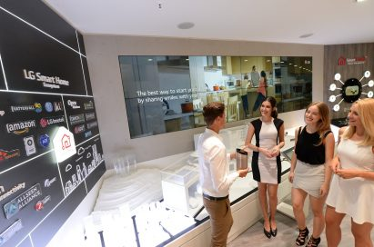 Male and female models and visitors at LG booth in IFA 2019
