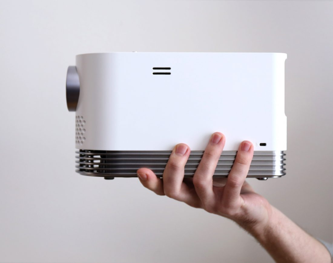 Side view of LG PROBEAM LASER PROJECTOR (MODEL HF80J) lifted by a man's hand