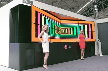 Two models are presenting LG Flexible Open Frame OLED Singage
