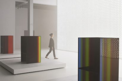 """A side view of a woman walking through the critically acclaimed """"TOKUJIN YOSHIOKA x LG: S.F_Senses of the Future"""" installation."""