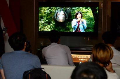 Viewers watching the Netflix series Okja on LG's 2017 model SIGNATURE OLED TV W