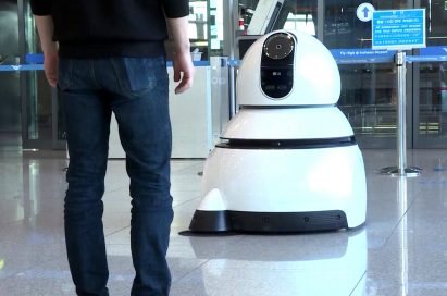 A front view of one of LG's Airport Cleaning Robots in action at the airport.