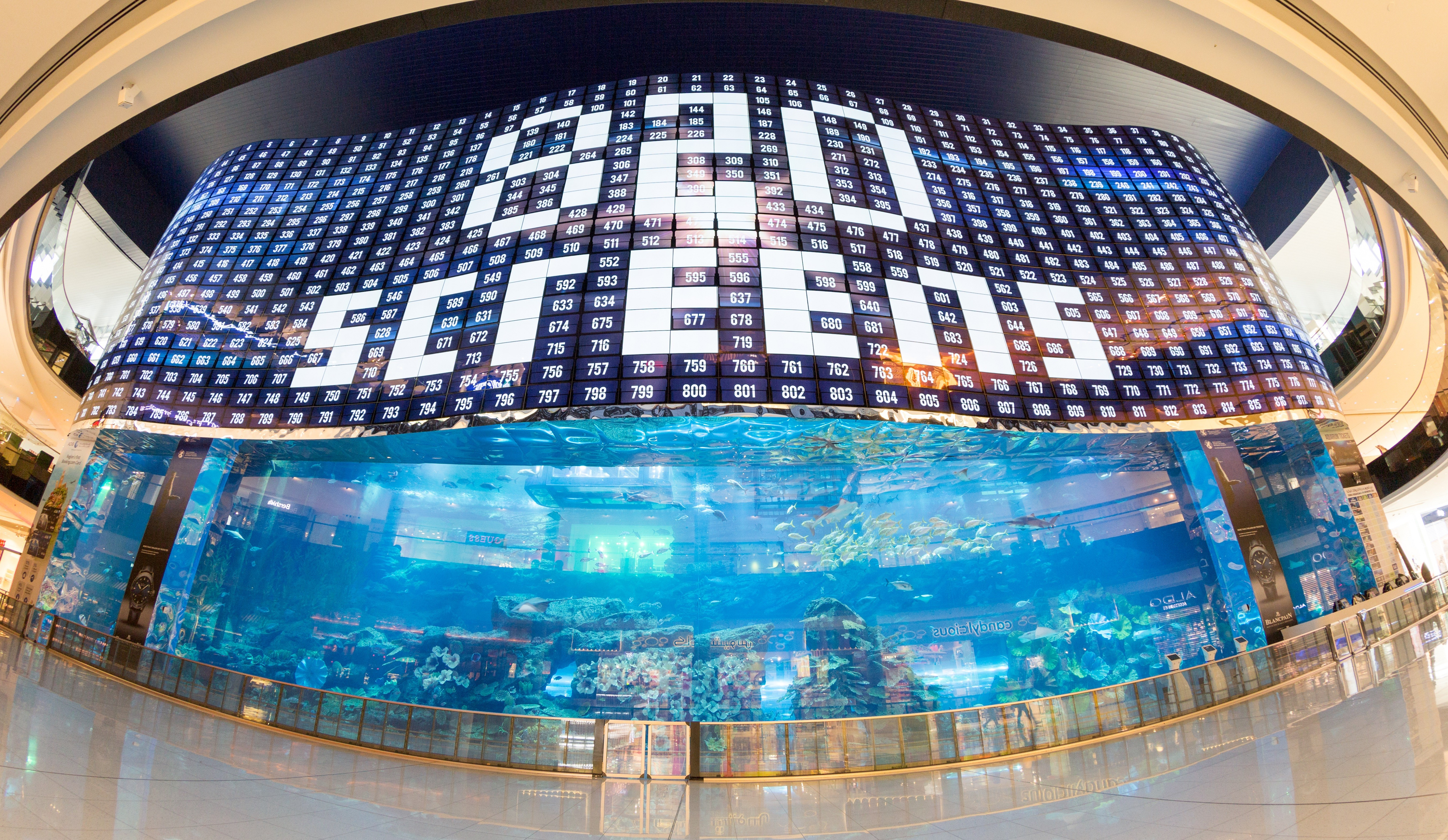 A gigantic LG OLED video wall signage displaying the fact that it uses '820 screens' at the Dubai Aquarium