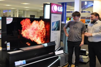 Visitors to LG's IFA booth admiring an LG OLED TV and its incredible picture quality