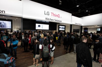 Many visitors discussing LG's products while taking a look around the LG ThinQ AI zone at LG's CES booth