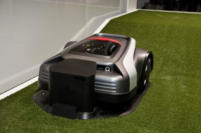 LG's CLOi LawnBot is placed on the artificial turf at LG's booth in order to show the way it works to meet American's domestic needs for lawn mower robots