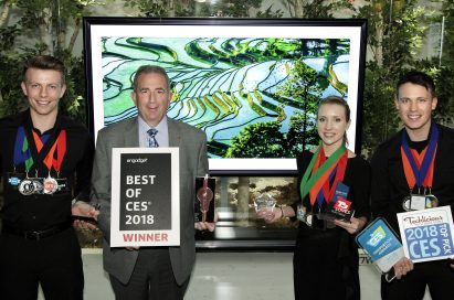 LG Electronics' USA head of Product Marketing for Home Entertainment Products, Tim Alessi and models pose with awards from Engadget, T3, Techlicious and more, after LG won numerous Best TV product honors at CES 2018.