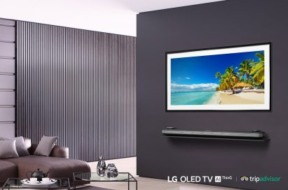 LG SIGNATURE OLED TV W in a modern-designed living room displays the tropical beach with coconut trees on its screen.