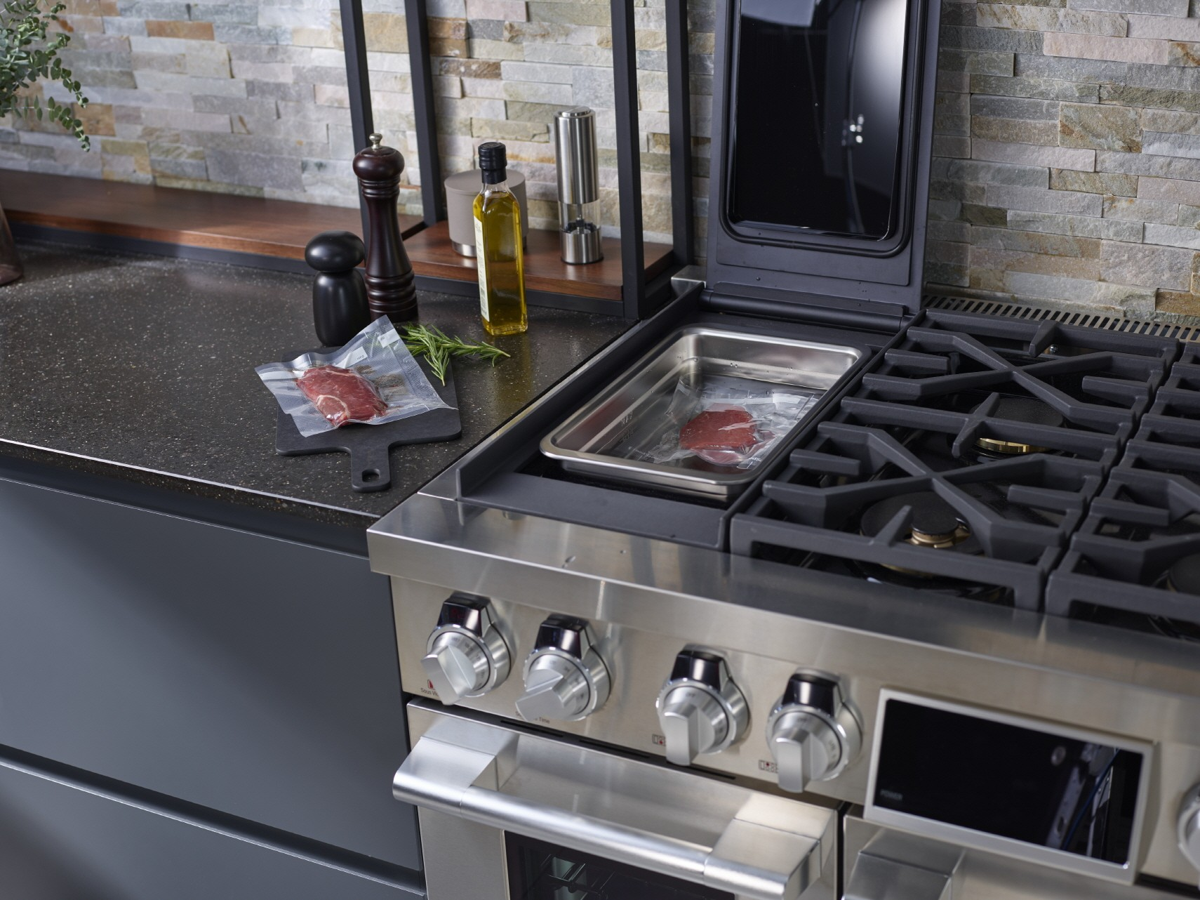 SIGNATURE KITCHEN SUITE oven induction cooktop with sous-vide section door open