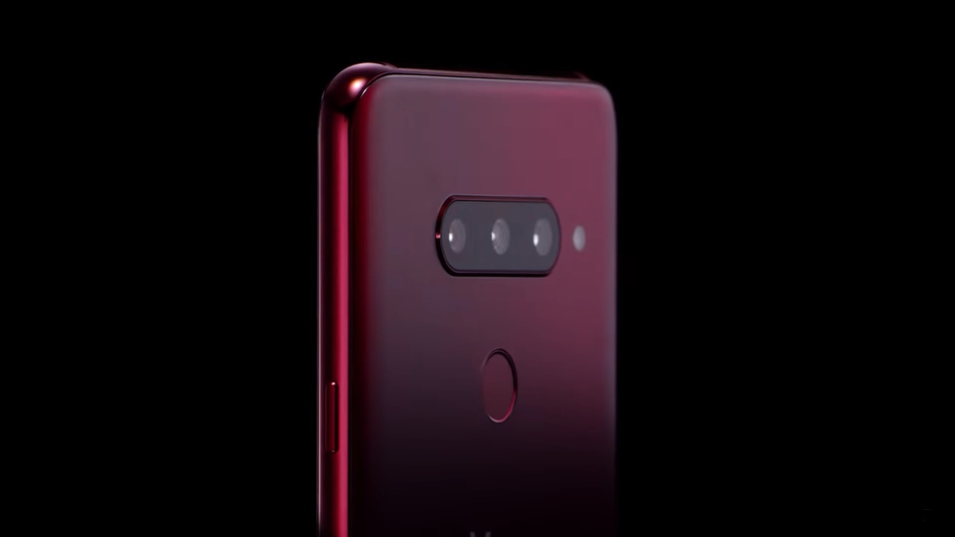 The top, rear half of the LG V40 ThinQ in Carmine Red, showing off the microscopic pits on the rear glass of the LG etched by employing the proprietary Silky Blast™ treatment