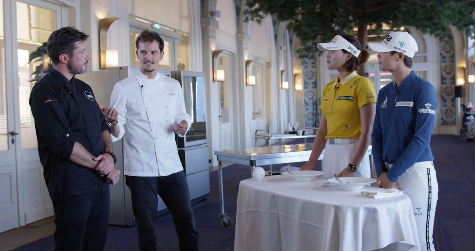 Two European star chefs – Juan Arbelaez and Christopher Crell, explain their signature cuisine to Korean golfers Park Sung-hyun and Chun In-gee who are competing at the 2018 Evian Championship.