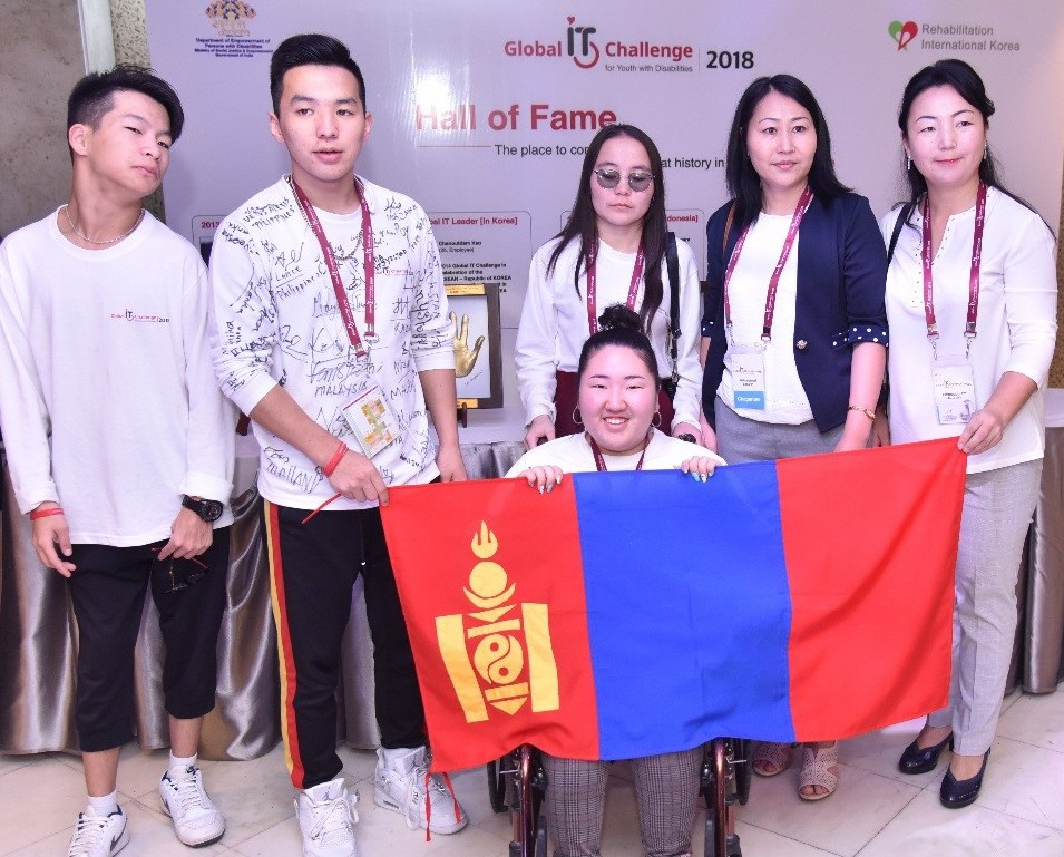 A group photo of the Mongolian participants holding up their national flag