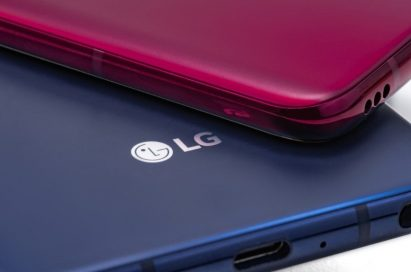 A Carmine Red LG V40 ThinQ is placed faced down on a New Moroccan Blue LG V40 ThinQ smartphone.