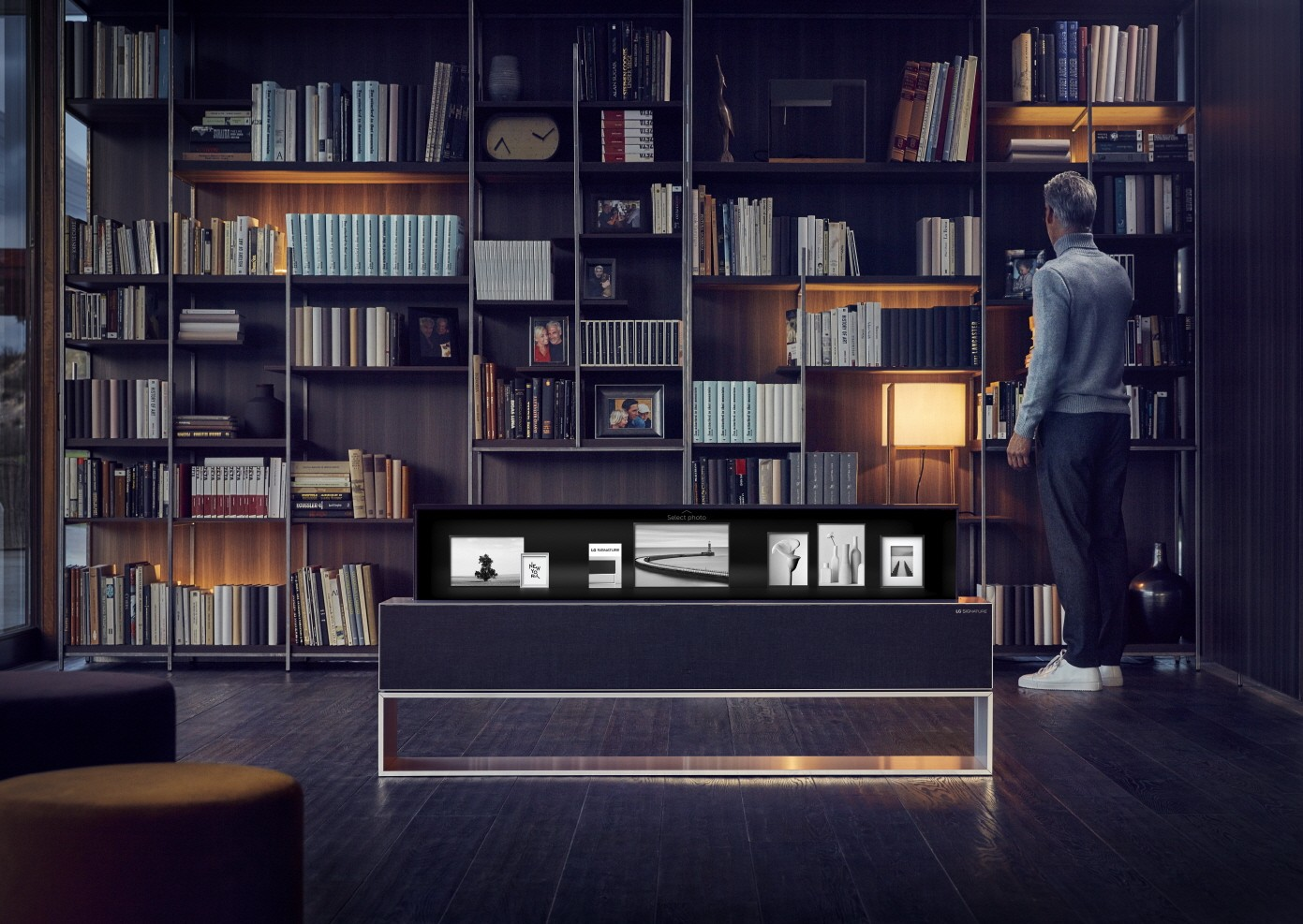 The LG SIGNATURE OLED TV R model 65R9 in its Line View in someone's study