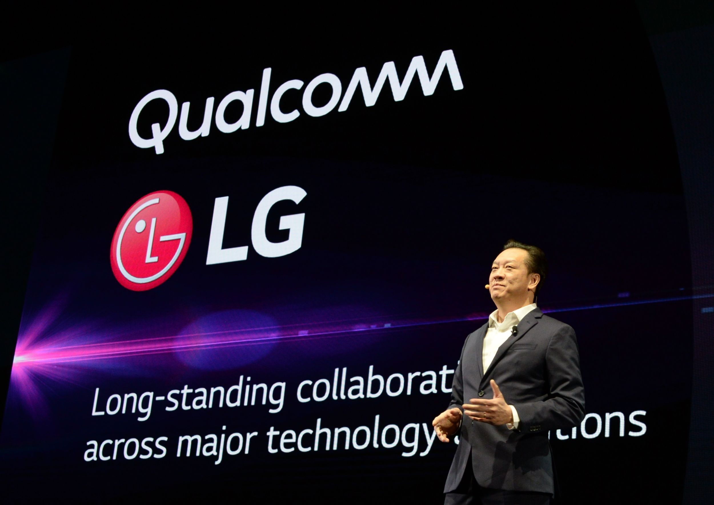 David VanderWall, Senior Vice President of Marketing at LG Electronics USA and Tim Alessi Senior Director of Product Marketing for Home Entertainment Products at LG Electronics USA are onstage demonstrate the half-rolled display position of the LG SIGNATURE OLED TV R at LG's CES 2019 Press Conference while putting the TV between them.