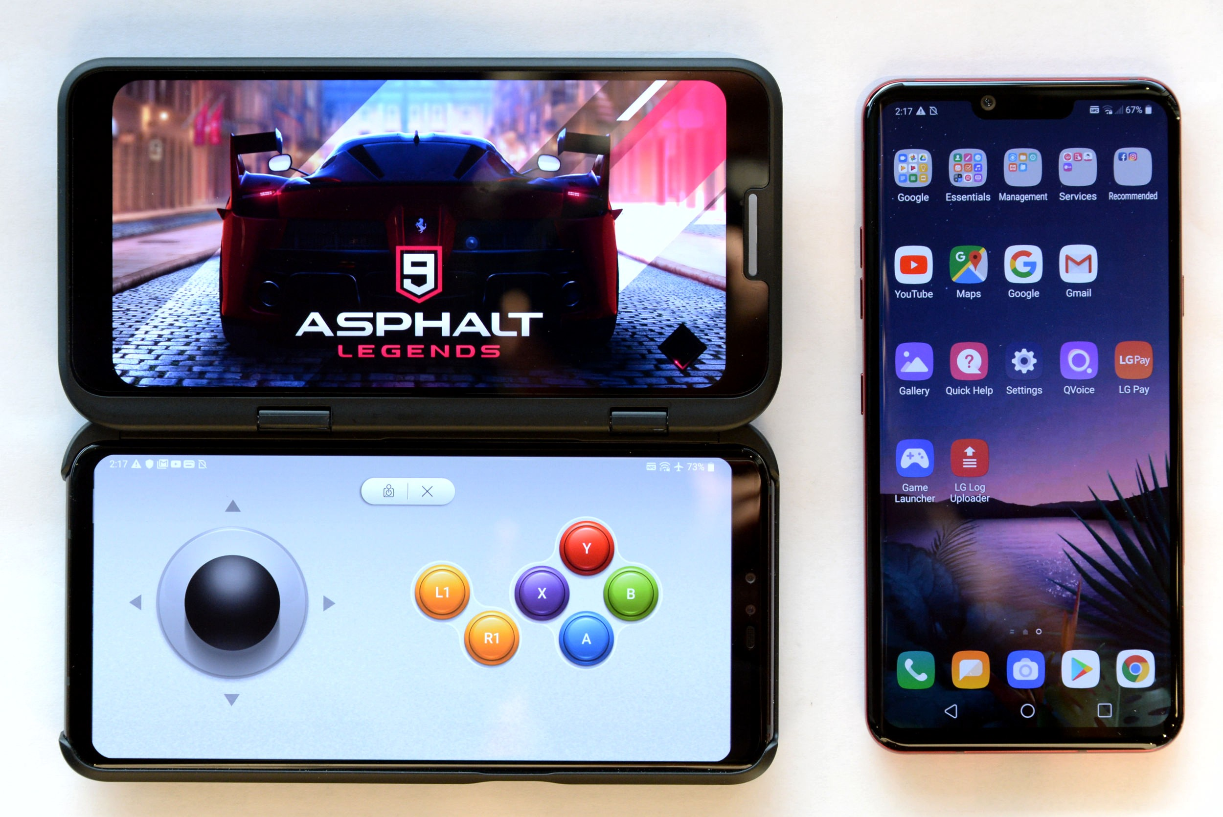 The front view of the LG V50 ThinQ 5G connected to the LG Dual Screen, with the Asphalt 9 Legends game on the top and LG Game Pad on the bottom, next to the LG G8 ThinQ