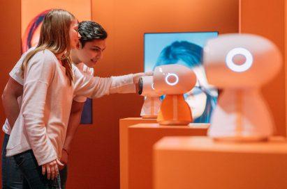 Models pose with LG's AI robot line, LG CLOi.