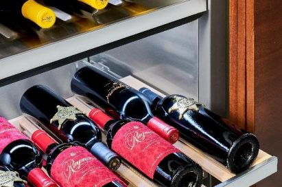 A look inside the Signature Kitchen Suite lineup's wine cellar, which is full of wine bottles.