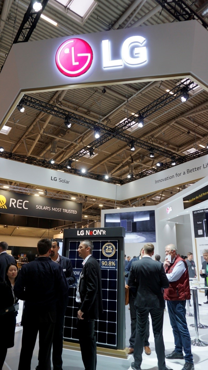 A group of visitors talk to each other at the entrance of LG's booth at Intersolar Europe 2019