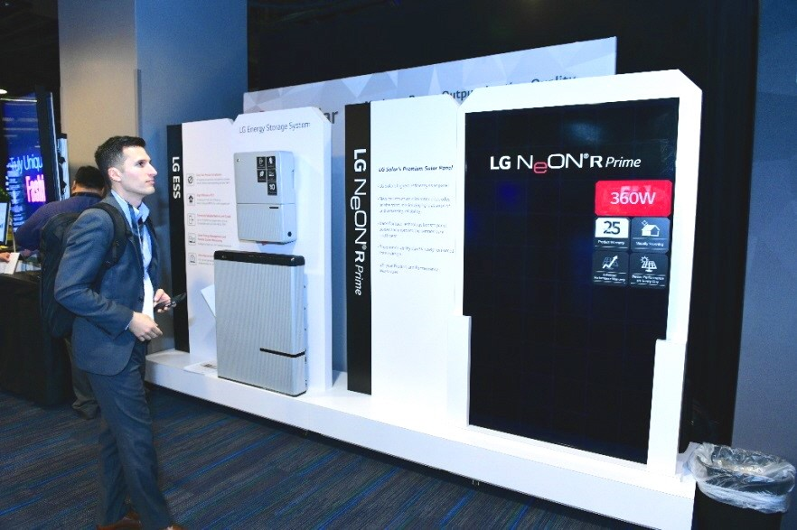 An event attendee looks at the introduction board about LG's flagship 60- and 72-cell LG NeON2 high-efficiency solar panels and LG's new energy storage systems.