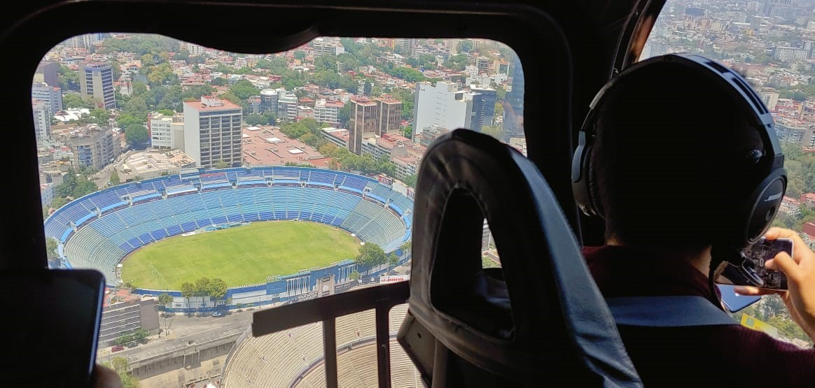 The pilot looks down to the Azul Stadium from the helicopter flying in the sky.