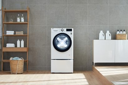 LG washing machine with AI DD™ in a laundry room
