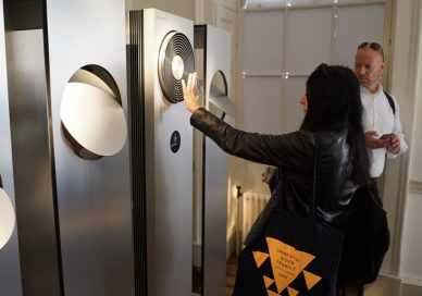 A visitor tests out an LG SIGNATURE Air Conditioner.