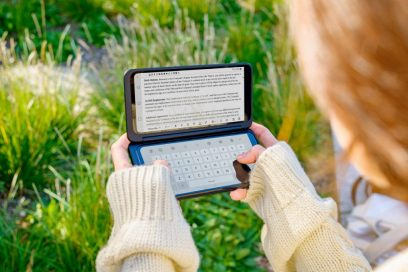 A woman holds the LG G8X ThinQ and the LG Dual Screen horizontally, with the Memo app on the Dual Screen and the LG Smart Keyboard on the main screen