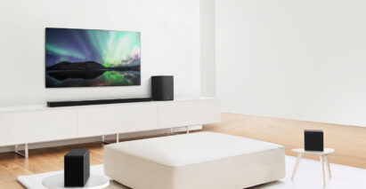 Wide-angle shot of LG SoundBar model SN11RG with 7.1.4-channel system installed under an LG TV in a modern living room setting
