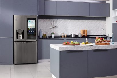 LG InstaView™ ThinQ refrigerator installed inside a modern kitchen with its Smart InstaView touch panel activated.