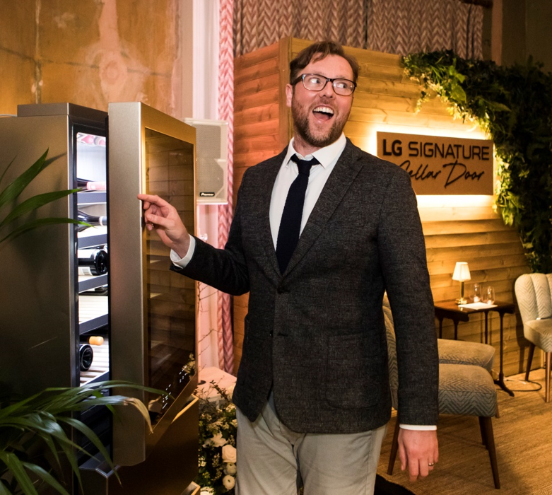 Damian Barr, London's famous novelist, looking thrilled as he opens the LG Wine Cellar
