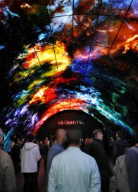 Attendees at CES 2017 walk under the LG OLED Tunnel, admiring the high picture and sound quality of LG's OLED TVs.
