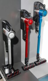 Three LG cordless vacuum cleaners in three different colors on display at LG's CES 2017 booth